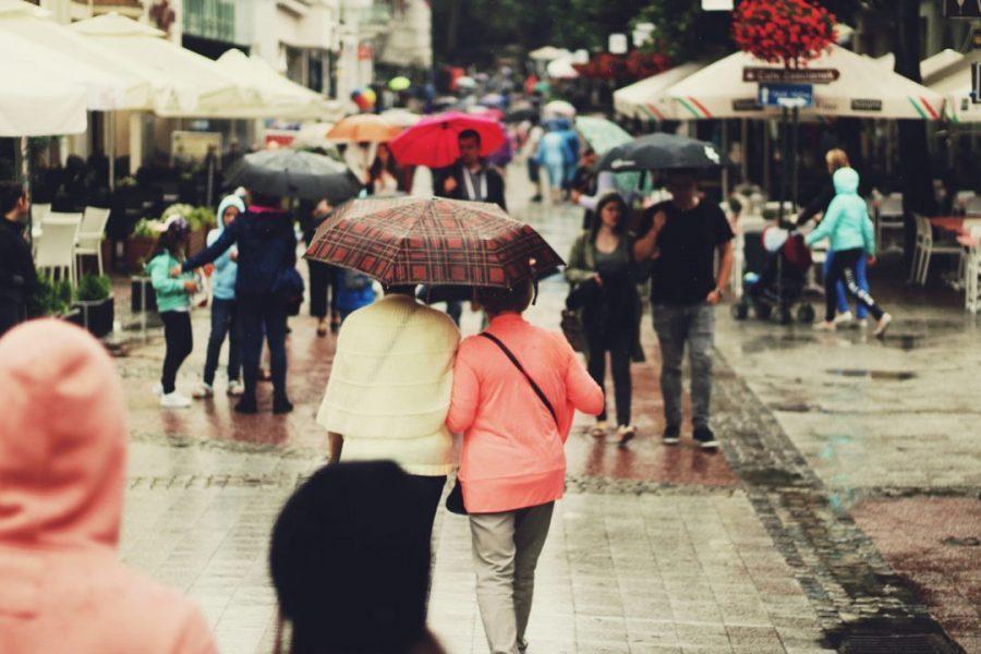 Walking in a rainy market