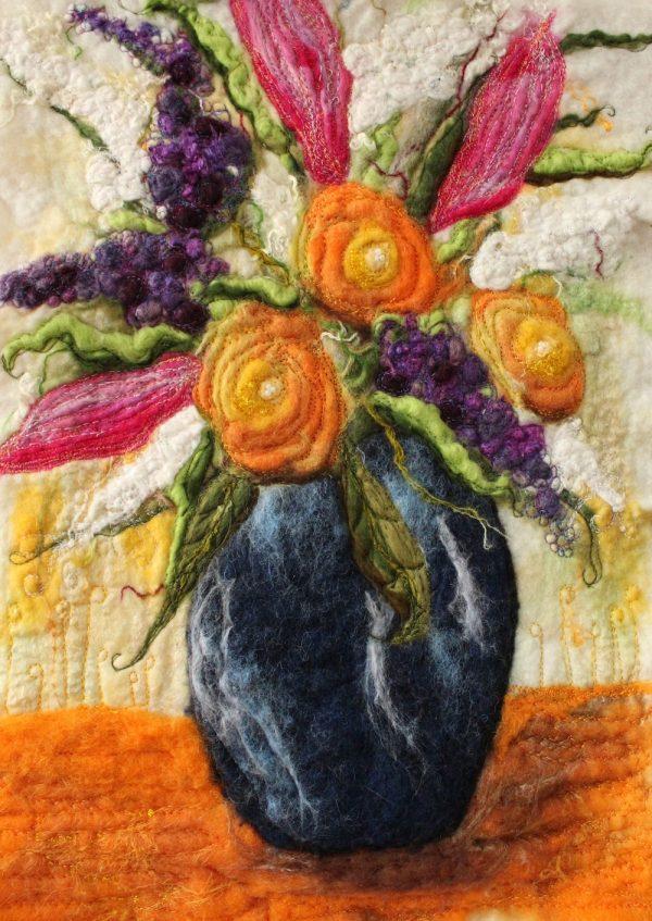 Blue vase of flowers in felt