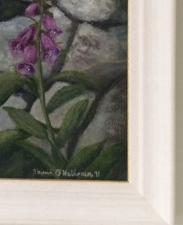 stone and purple flowers with frame