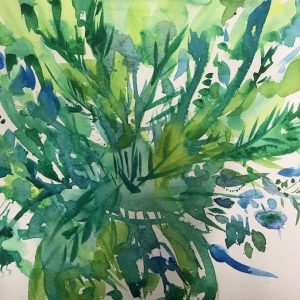Green and blue vase of flowers