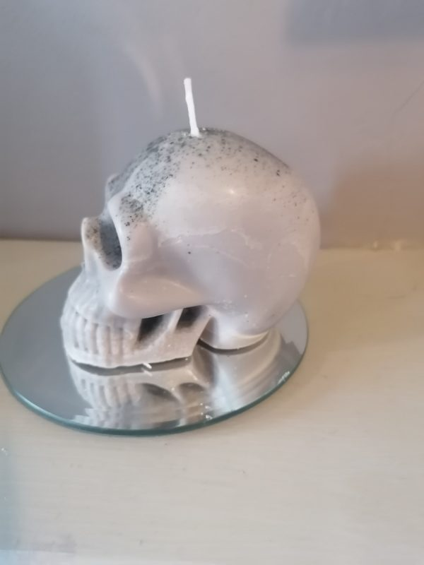 Left Facing Skull Candle on round mirror