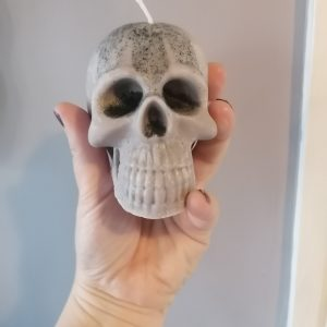 Woman holding a skull candle in her hand